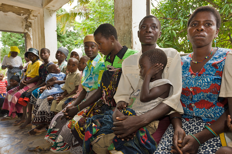 HIV/AIDS clinic mothers with children waiting<p> outside a dispensary